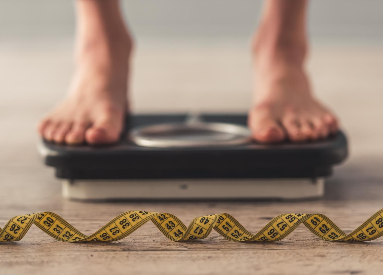 women standing on weighing machine